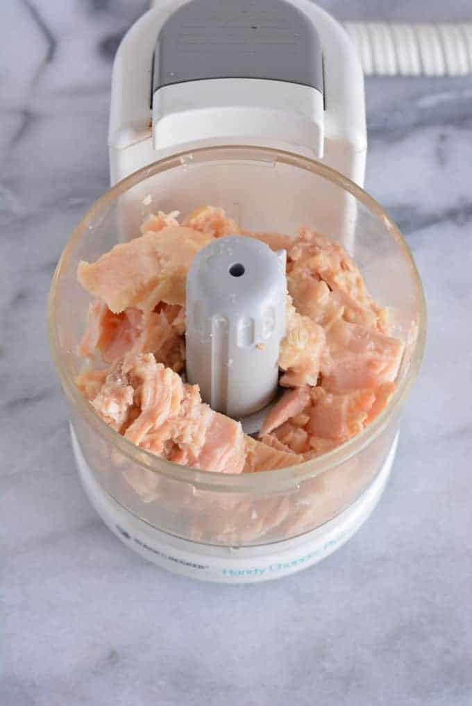 Tuna chunks in a food processor.