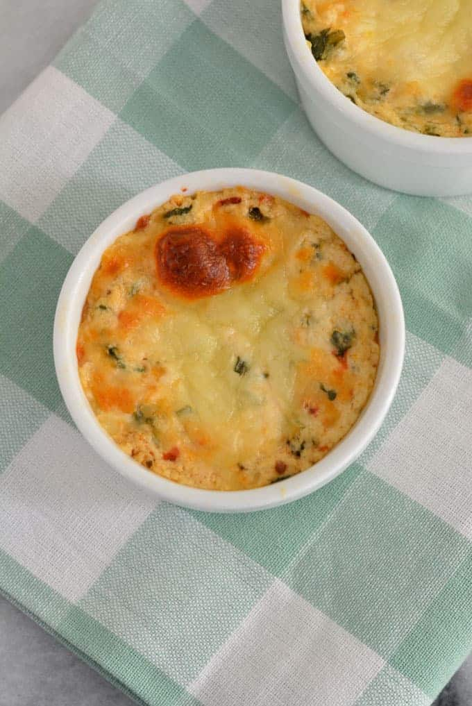 Baked ricotta in a white ramekin with sun-dried tomatoes.